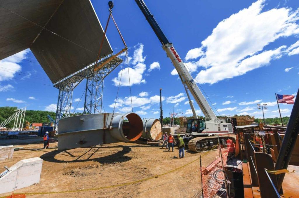 Crane lifting industrial materials