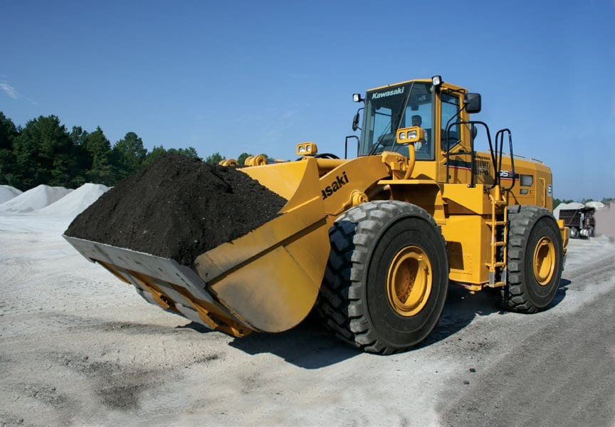 Kawasaki bulldozer with a bucket full or dirt